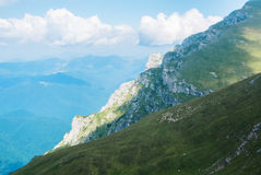 Panoramic view over the Carpatian mountains, green valleys and b Royalty Free Stock Photos