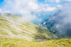 Panoramic view over the Carpatian mountains, serpentine path and Royalty Free Stock Photography