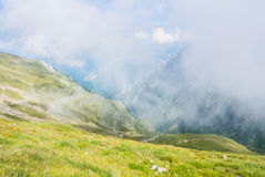 Panoramic view over the Carpatian mountains, serpentine path and Royalty Free Stock Images