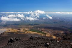 Panoramic view over the clouds from Etna at Mediterranean sea, Sicily, Italy Royalty Free Stock Images