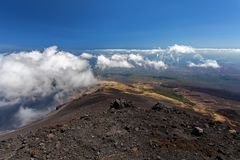 Panoramic view over the clouds from Etna at Mediterranean sea, Sicily, Italy Royalty Free Stock Photo
