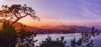 Panoramic view over a coastal town at sunset Royalty Free Stock Photos