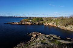 Panoramic view over deep blue baltic sea and island of Suomenlinna to Helsinki royalty free stock photos