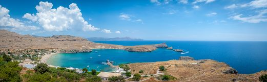 Panoramic view over local beach in an enclosed bay in Lindos village famous for an ancient Acropolis. Island of Rhodes. Greece. stock photography
