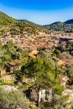 Mediterranean village Esporles with picturesque mountain landscape on Majorca. Panoramic view over the mediterranean small town of Esporles, Mallorca Spain stock photo