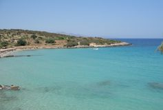 Panoramic view over Mirabello Bay. At Crete (Greece) with fantastic colored sea on a bright summer day Royalty Free Stock Photo