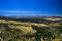Panoramic view over rural wide valley contrasting with cloudless blue sky from ancient village Ronda - Andalusia, Spain royalty free stock photography