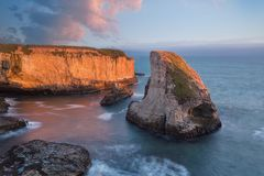 Panoramic view over Shark Fin Cove Shark Tooth Beach. Davenport, Santa Cruz County, California, USA. Sunset in California. Waves and sun hitting these stock images