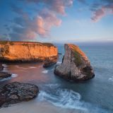 Panoramic view over Shark Fin Cove Shark Tooth Beach. Davenport, Santa Cruz County, California, USA. Sunset in California. Waves and sun hitting these stock photos