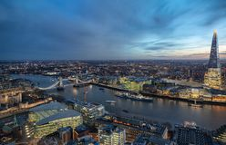 Panoramic view over the skyline of London by night. Along the Thames river to the Tower Bridge royalty free stock images