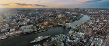 Panoramic view over the skyline of London during sunset time. From the Tower Bridge along the Thames to Canary Wharf stock photo