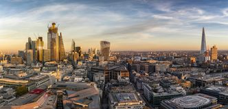 From the City to Tower- and London Bridge during sunset time. Panoramic view over the skyline of London, United Kingdom, during sunset time: from the City to stock photos
