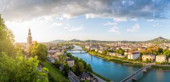 Panoramic view over Stadt Salzburg with Salzach river in the eve Stock Photography