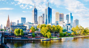 Panoramic view over Yarra River and City Skyscrapers in Melbourne, Australia. Melbourne, Australia - February 20, 2015: Panoramic view over Yarra River and City Royalty Free Stock Photography