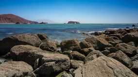 Goat Rock beach at Sonoma State park. Panoramic view of the Pacific Coast from Goat Rock beach, featuring arched rock at Sonoma Coast, California, USA, on a stock photography