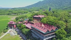 Panoramic View Pagoda Territory against Highlands Rice Fields. Panoramic view gorgeous religious pagoda territory among tropical plants against highlands and stock video