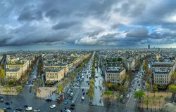 Panoramic view of Paris from the Arc de Triomphe. Autumn. Rain. Sun Royalty Free Stock Photography