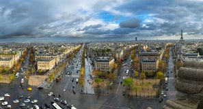 Panoramic view of Paris from the Arc de Triomphe. Autumn. Rain. Sun Royalty Free Stock Photos
