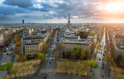 Panoramic view of Paris from the Arc de Triomphe. Autumn. Rain. Sun Royalty Free Stock Image