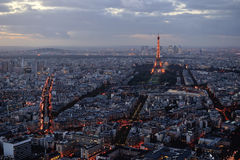 Panoramic view of Paris at sunset. A high panoramic view of the Eiffel Tower in Paris taken from the Montparnasse Tower after sunset Royalty Free Stock Photography