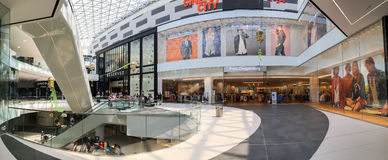 Panoramic View Of People Crowd Rush In Shopping Luxury Mall Interior. BUCHAREST, ROMANIA - MAY 30, 2016: Panoramic View Of People Crowd Rush In Shopping Luxury Stock Image