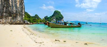 Panoramic view of perfect Thailand beach with white sand and traditional long boats royalty free stock photography