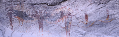Panoramic view of Petroglyphs of stick figures from Atlati Rock, NV Stock Images