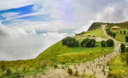 Panoramic view at the Pichincha volcano, with some native andes plants and horses with a typical hut in the horizont, in Royalty Free Stock Images