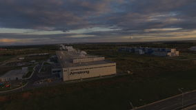 Panoramic View Plant with Brand Armstromg against Sunset. KAZAN, TATARSTAN/RUSSIA - JUNE 08 2015: Panoramic view large plant territory with modern white building stock footage