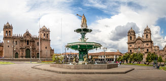 Panoramic view of Plaza de Armas with Inca fountain, Cathedral and Compania de Jesus Church - Cusco, Peru royalty free stock images