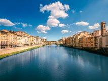 Panoramic view of Ponte Vecchio Bridge, Florence. Panoramic view of Ponte Vecchio Bridge Florence with dramatic cloudy sky and reflection on river, Italy stock photos