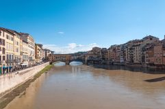 The Ponte Vecchio bridge in Florence, Italy. Panoramic view of the Ponte Vecchio bridge and river Arno on a sunny day in Florence, Italy Royalty Free Stock Photography