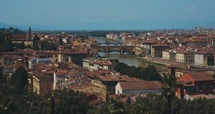 Panoramic view of Ponte Vecchio. The view of Ponte Vecchio, the famous Arno river bridge from Uffizi Gallery. Also known as `Old Bridge`, it is one of the great stock video