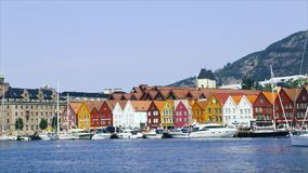 Panoramic view of Port Bergen in Norway, Scandinavia. Bergen, Norway, Scandinavia, July 2019: Port of Bergen with view on the historical buildings of Bryggen in stock video footage