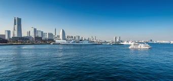 Panoramic view of a port city. Yokohama Minato Mirai 21 Area in. Yokohama, viewed from Osanbashi Pier Royalty Free Stock Images