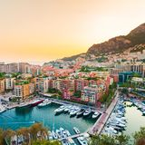 Panoramic view of Port de Fontvieille in Monaco. Azur coast. Colorful bay with a lot of luxury yachts in sunset Royalty Free Stock Photos