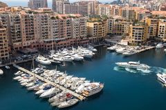 Port de Fontvieille in Monte Carlo - Monaco. Panoramic view of Port de Fontvieille in Monaco. Azur coast. Luxury yachts in Monte Carlo Royalty Free Stock Images