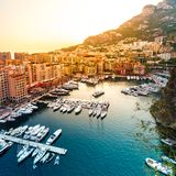 Panoramic view of Port de Fontvieille in Monaco. Azur coast. Colorful bay with a lot of luxury yachts in sunset Stock Photography