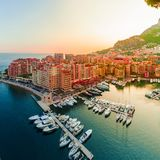 Panoramic view of Port de Fontvieille in Monaco. Azur coast. Colorful bay with a lot of luxury yachts in sunset Royalty Free Stock Images