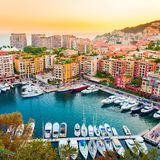 Panoramic view of Port de Fontvieille in Monaco. Azur coast. Colorful bay with a lot of luxury yachts in sunset Royalty Free Stock Photo