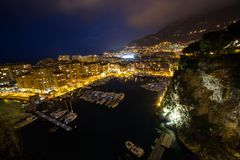 Panoramic view of Port de Fontvieille at night in Monaco. Azur c Stock Images
