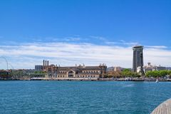 Panoramic view of the Port Vell with the building of the State Agency for Tax Administration in the middle and Columbus Monument. Panoramic view of the Port Vell Royalty Free Stock Image