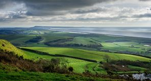 Panoramic view of Portand and Chesil Beach in Dorset. Panoramic view of Portand and Chesil Beach from the hill tops near Abbotsbury in Dorset, UK stock photography