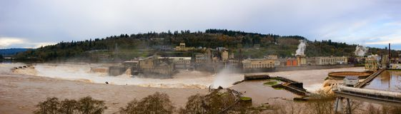 Panoramic View of Power Plant and paper mill ruins in Oregon Cit. Panoramic view from above Oregon City of the Willamette River nears flood stage. The ruins of royalty free stock photography