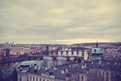 Panoramic view on Prague at dawn; retro Instagram style Stock Photos