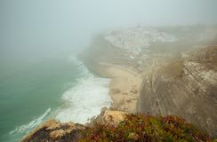 Panoramic view of Praia das Azenhas do Mar. Sintra, Portugal. Praia das Azenhas do Mar beach in Colares, Portugal, on a foggy day. Summer. View of the Atlantic stock photo