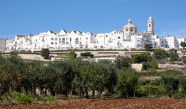 Panoramic view of the pretty town of Locorontondo, Puglia, southern Italy. Photo shows the town at the top of the hill stock image