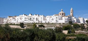 Panoramic view of the pretty town of Locorontondo, Puglia, southern Italy. Photo shows the town at the top of the hill. With terraces below royalty free stock images