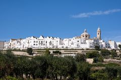 Panoramic view of the pretty town of Locorontondo, Puglia, southern Italy. Photo shows the town at the top of the hill. With terraces below royalty free stock photos