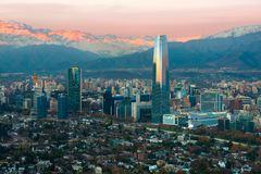 Panoramic view of Providencia and Las Condes districts with The Andes Mountain Range at sunset, Santiago Stock Photo